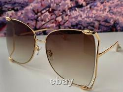 Gucci GG0252S Gold Frame Brown Lens Women's Oversize Sunglasses Butterfly