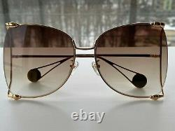Gucci GG0252S Gold Frame Brown Lens Women's Sunglasses Oversize Butterfly
