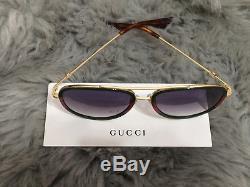 Gucci Lunettes De Soleil Design Pour Femmes Gg0062s 003 Green Gold / Grey